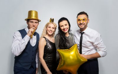 celebration, fun and holidays concept - happy friends posing with golden party props